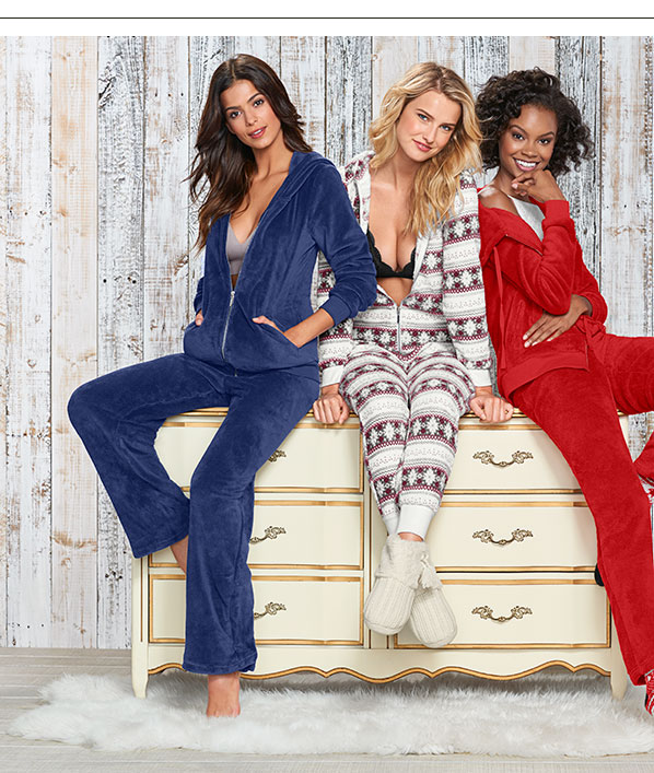 Three girls in holiday pajamas.
