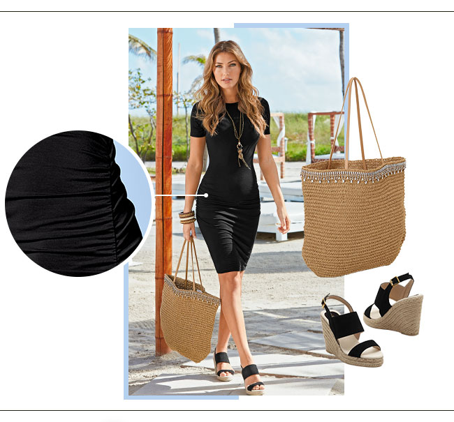 Woman, walking down the beach, wearing a black mini dress with ruching on  the
