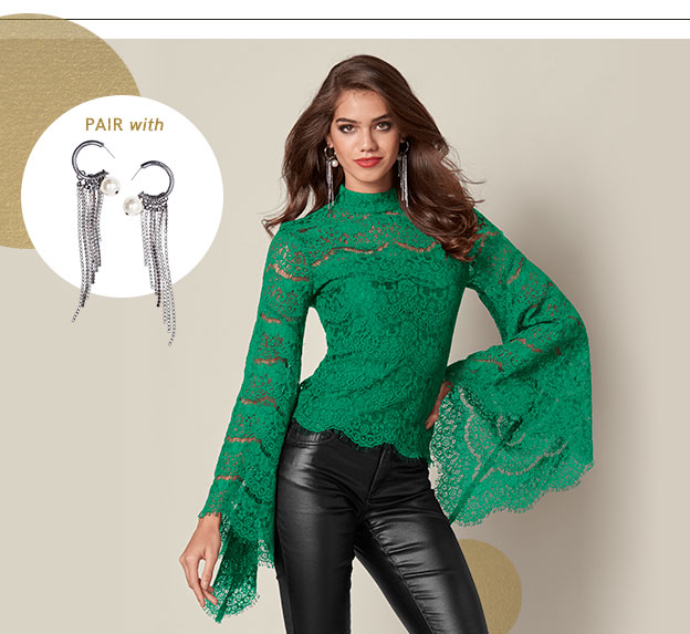 Woman wearing green flaired party Top.