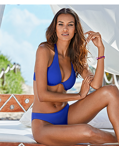 Woman wearing a blue solid underwire bikini.